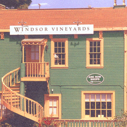 The original building and tasting room for Windsor Vineyards - a green building with stairs leading up to the tasting room